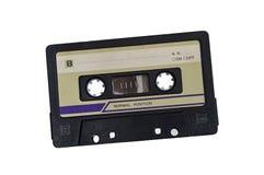 Старая магнитофонная кассета на белой предпосылке Стоковое Фото