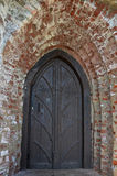 Старая массивнейшая деревянная дверь Стоковые Изображения