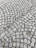 Старая мощенная булыжником дорога Камни штабелированы одно до одно Стоковые Фото