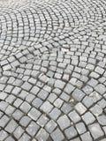 Старая мощенная булыжником дорога Камни штабелированы одно до одно Стоковые Изображения