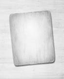 Старая пакостная бумага с тенью на белом деревянном suface стены или столешницы Стоковые Фото
