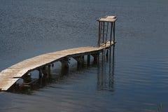 Старая пристань на воде Стоковая Фотография