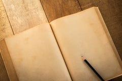 Старая пустая книга открытая с pancil Стоковые Фотографии RF