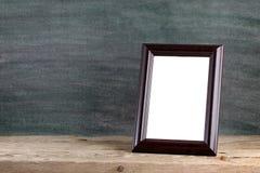 Старая рамка фото на таблице Стоковое Фото