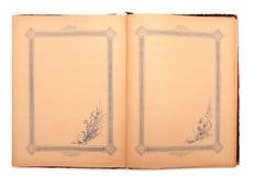 Старая раскрытая украшенная тетрадь Стоковое Фото
