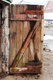 Старая распаденная деревянная дверь Стоковые Фото