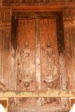 Старая древесина искусства Лаоса высекая на церков в виске Si Saket в Лаосе. Стоковое Изображение