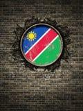Старая республика флага Намибии в кирпичной стене Стоковые Фото
