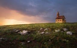 Старая римская церковь на заходе солнца в Drazovce, Словакии Стоковое фото RF