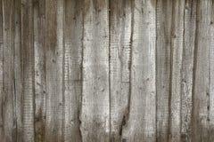 Старая серая загородка сделанная из древесины с белыми ходами краски стоковое фото rf