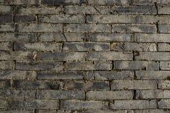 Старая серая кирпичная стена Стоковые Изображения RF