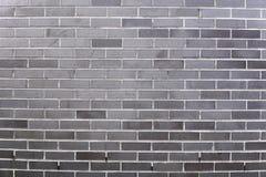 Старая серая предпосылка кирпичной стены стоковое фото rf