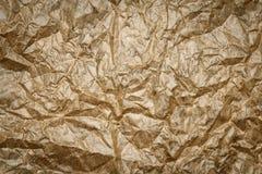 Старая скомканная текстура пергамента Бежевая бумажная предпосылка листа, морщинка, сгорела стоковое фото