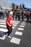 Старая старшая женщина с розой Стоковое фото RF