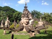 Старая статуя в Loas Стоковые Фото