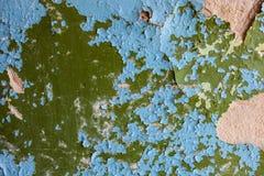 Старая стена с богатой текстурой треснутой голубой и зеленой краски Стоковое Изображение RF