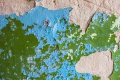 Старая стена с богатой текстурой треснутой голубой и зеленой краски Стоковое Фото