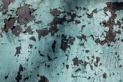 Старая стена черная и покрашенная синь треснули предпосылку текстуры Стоковая Фотография RF