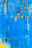 Старая текстурированная голубая стена с пятнами Стоковая Фотография