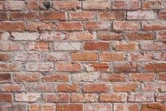 Старая текстурированная красная кирпичная стена Стоковые Фото