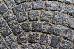 Старая темная картина пола камня гранита как предпосылка в Италии Стоковая Фотография RF