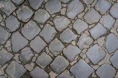 Старая темная картина пола камня гранита как предпосылка в Риме, Стоковые Фотографии RF