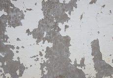 Старая треснутая краска на бетонной стене Стоковое Изображение