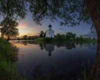 Старая церковь на береге озера Стоковое Фото