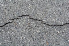 Старая черная дорога с утилями порошка стоковое фото
