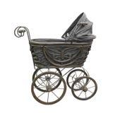 Старая черная изолированная детская дорожная коляска Стоковые Фотографии RF