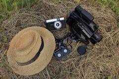 Старая шляпа, камера, видеокамера и патрон с фильмом Стоковые Изображения RF