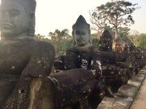 стародедовская статуя Гигантская каменная сторона боги индусские Камбоджа Стоковое Фото