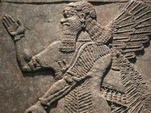 Стародедовские ассирийские carvings стены Стоковая Фотография