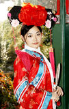 стародедовские китайцы одевают девушку Стоковая Фотография RF