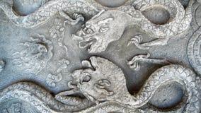 стародедовский камень дракона carvings стоковые фото