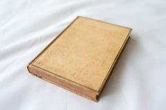 Старое коричневое книга в твердой обложке книги Стоковое Фото