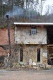 Старое огорченное используемое здание Стоковое Изображение