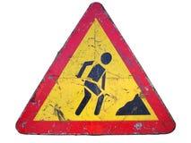 Старое пакостное ржавое триангулярное красное ` дорожного знака границы под стройкой Стоковые Фотографии RF