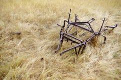 Старое покинутое оборудование сельского хозяйства Стоковое Фото