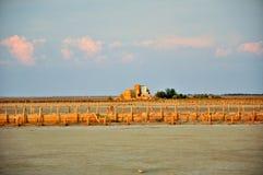 Старое соленое болото и заход солнца Стоковое Фото