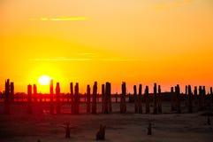 Старое соленое болото и заход солнца Стоковые Фото