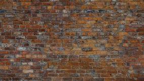 Старой предпосылка текстурированная кирпичной стеной Стоковое Изображение