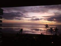 Старт восхода солнца, который нужно прийти на пляж sanur Стоковая Фотография RF
