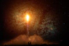 Старт ракеты на ноче стоковое фото