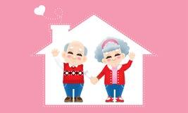 Старшая восточная пара с костюмом зимы и предпосылкой дома стоковые фотографии rf