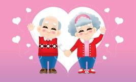 Старшая восточная пара с костюмом зимы и предпосылкой любов стоковое фото rf