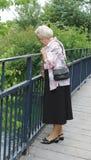 Старшая дама смотря в реку Стоковое фото RF