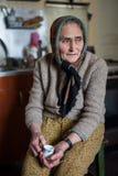 Старшая женщина крытая Стоковое фото RF