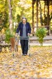 Старшая женщина при ходок идя outdoors Стоковые Изображения RF