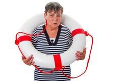 Старшая женщина с спасателем Стоковая Фотография